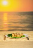 Romantic dinner from pancakes with a salmon. Against a decline Royalty Free Stock Photography