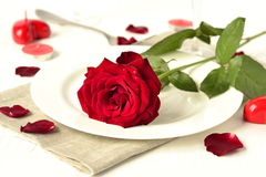 Romantic dinner with red roses and candles Royalty Free Stock Images