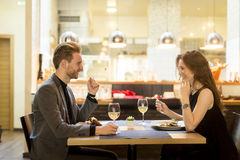 Romantic dinner in restaurant. Young couple in the restaurant and have a romantic dinner Royalty Free Stock Photo