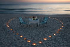 Romantic dinner on the sea beach with candle heart Royalty Free Stock Image