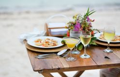 Romantic dinner served for two on a beach royalty free stock photos