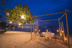 Romantic dinner set up on the beach Royalty Free Stock Photos