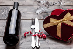 Romantic dinner set on wooden background Stock Photos