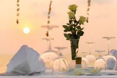 Romantic dinner setting. On the beach at sunset Royalty Free Stock Photography