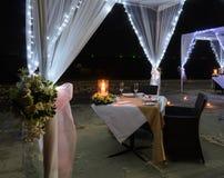 Romantic dinner setup on beach at night Royalty Free Stock Photo