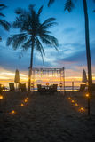 Romantic dinner setup on the beach. Sunset Royalty Free Stock Photography