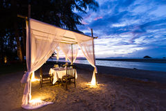 Romantic dinner setup. On the beach while twilight stock photography