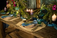 Romantic dinner setup or Holiday table setting, red decoration with candle light. stock photography