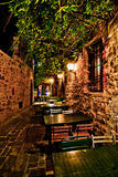 Romantic dinner in small Italian restaurant. Romantic dinner at night in a small Italian restaurant with outdoor garden Royalty Free Stock Image