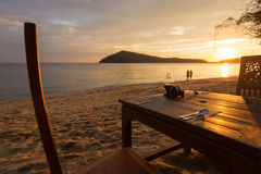 Romantic dinner with sunset, beach and ocean on Koh Chang Island Royalty Free Stock Photography