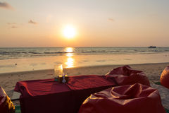 Romantic dinner with sunset, beach and ocean on Koh Chang Island Royalty Free Stock Image