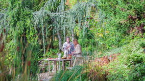 Romantic dinner at the table in beautiful park stock video