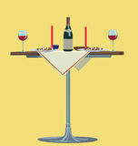 Romantic dinner. Table with a bottle of wine, glasses and candles Royalty Free Stock Images