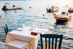 Free Romantic Dinner Table By The Sea Santorini, Greece Royalty Free Stock Images - 154101909