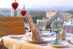 Romantic dinner table set Stock Photos