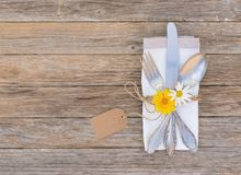 Romantic dinner table setting with flowers and empty name tag Stock Images
