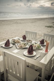 Romantic dinner table setup on tropical beach Royalty Free Stock Photography