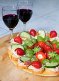 Romantic dinner for two. Red wine, delicious canapes and fruits. Focus on snacks Stock Image