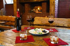 Romantic dinner for two near fireplace Royalty Free Stock Photography