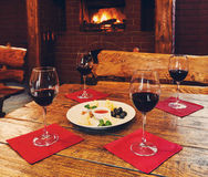 Romantic dinner for two near fireplace Stock Image