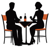 Romantic dinner for two. The silhouette of a young couple at the table with a bottle of wine Stock Image