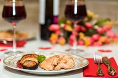 Romantic dinner for two with wine,meat and flowers Stock Images