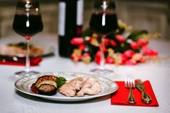 Romantic dinner for two with wine,meat and flowers Royalty Free Stock Photos