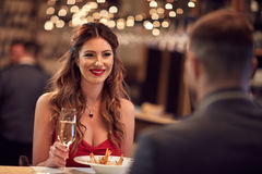 Romantic dinner for Valentine`s day. Couple celebrate Valentine`s day with romantic dinner in restaurant Royalty Free Stock Photo