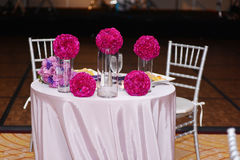Romantic dinner with water glasses and flowers Stock Photo