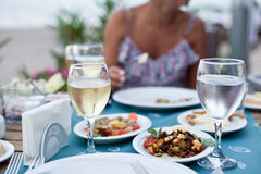Romantic dinner with white wine. Royalty Free Stock Photo