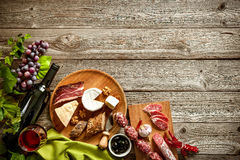 Romantic dinner with wine, cheese and traditional sausages Stock Photo