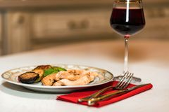 Romantic dinner with wine, meat and vegetables Royalty Free Stock Photography