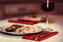 Romantic dinner with wine, meat and vegetables Royalty Free Stock Image