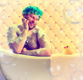 Romantic dreamer taking bath Stock Photos