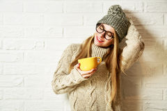 Romantic Dreaming Hipster Girl in Winter Clothes with a Mug Stock Photography