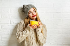 Romantic Dreaming Winter Hipster Girl with a Mug Royalty Free Stock Image