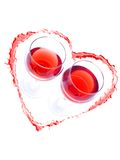 Romantic drink. Two glasses of red wine inside red heart drawn with wine on white background Royalty Free Stock Photos