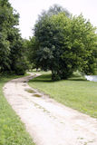 Romantic dusty road in countryside rural scene Royalty Free Stock Photos