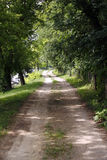 Romantic dusty road in countryside rural scene Royalty Free Stock Image