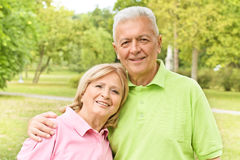 Romantic elderly couple. Portrait of romentic elderly couple outdoors royalty free stock image