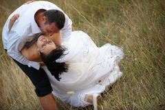 Romantic embrace (bride and groom) Stock Images