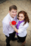 Romantic embrace on a date in city park. With red flower Royalty Free Stock Images