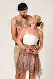 Romantic embrace of a stylish couple in summer dress Royalty Free Stock Image