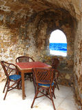Romantic empty table. Derelicted taverna in Greece in the end of summer season with the view to the sea Stock Images