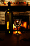Romantic evening. Wine, glasses and a warm fire for a romantic evening stock image