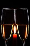 Romantic evening. Glasses. Champagne. Candle. Black background. Vertical Royalty Free Stock Photos