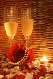 Romantic Evening. Romantic Dim Lit Restaurant setting with rose and pearls Royalty Free Stock Photos