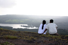 Romantic Evening. A young romantic Indian couple on a hilltop on an evening Royalty Free Stock Photography