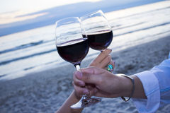 Romantic evening. Romantic beach evening on the sunset: two glasses of wine, candles, shells, valentines day Stock Photos