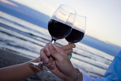 Romantic evening. Romantic beach evening on the sunset: two glasses of wine, candles, shells, valentines day Stock Images